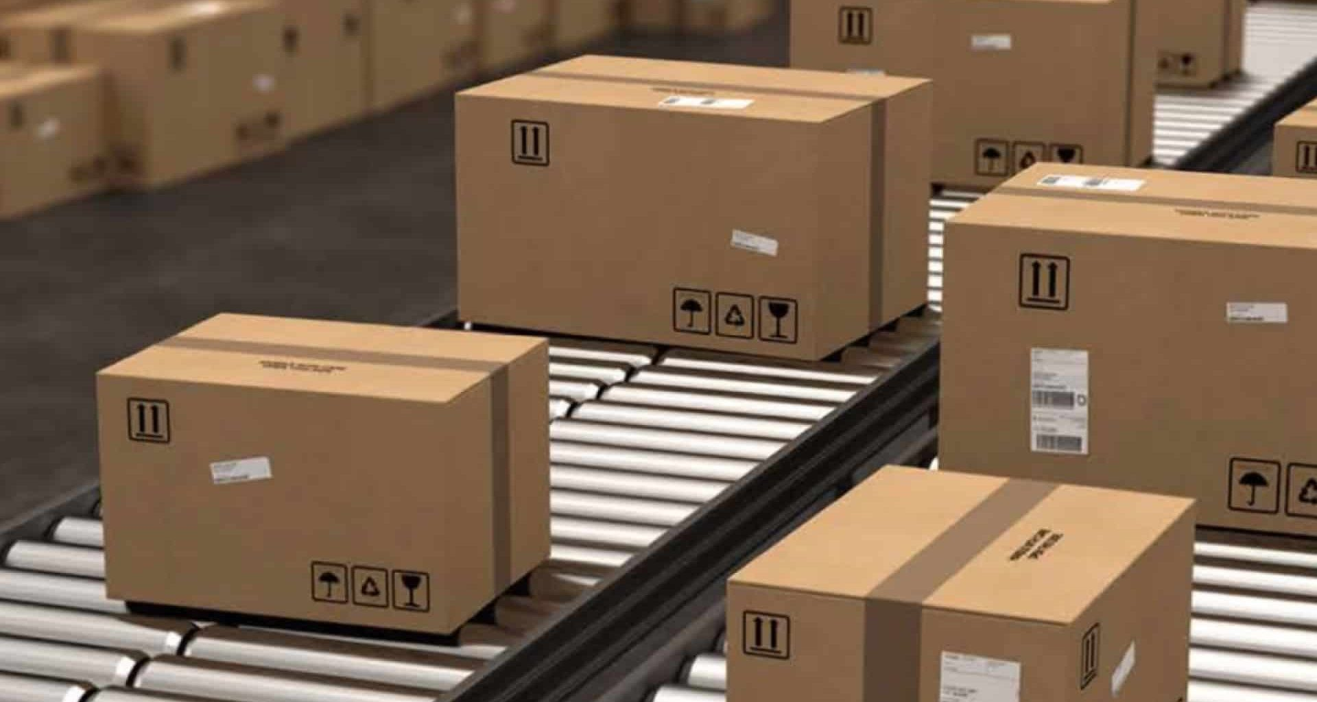cardboard boxes on metals rollers in shipping facility